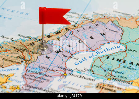 Photo of Sweden marked by red flag in holder. Country on European continent. - Stock Photo