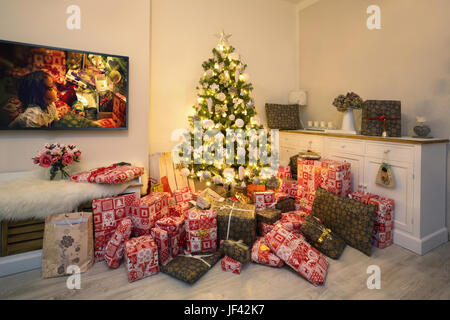 Christmas Tree In Living Room bright christmas tree in living room with burning fireplace and