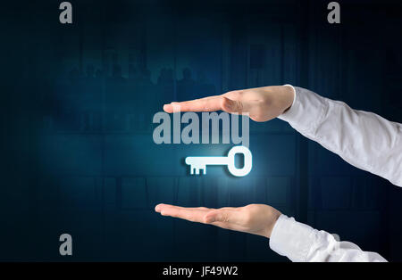 Key to success and business solution concept. Protecting gesture of businessman and symbol of a key and business - Stock Photo