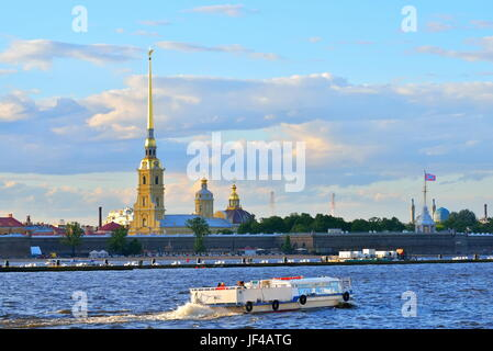 Pleasure boat floats on the Neva river on the background of the fortress in Saint-Petersburg. - Stock Photo