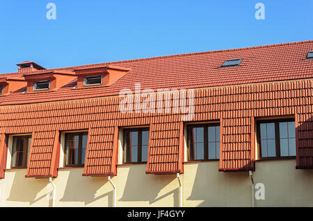 New red tiled roof of the house - Stock Photo