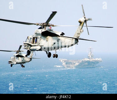 Two HH-60H Seahawk helicopters assigned to the 'Dusty Dogs' of Helicopter Anti-Submarine Squadron Seven (HS-7), - Stock Photo