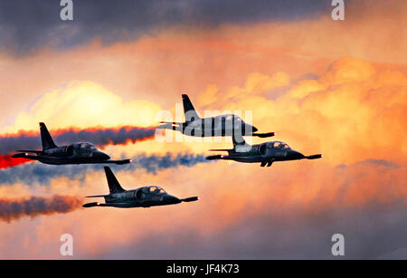 Patriot L-39 jets fly in formation against a golden cloudbank over Marine Corps Air Station Miramar.