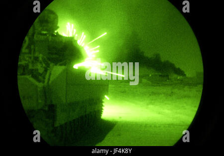 040930-F-2034C-012 An Army Bradley Fighting Vehicle opens fire with its 25-millimeter machine gun on anti-coalition - Stock Photo