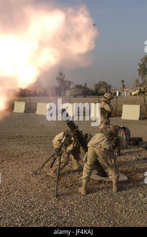 041214-A-3978J-033 U.S. Army soldiers fire 120mm mortars to calibrate the systems at Forward Operation Base Marez - Stock Photo