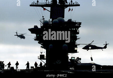 Navy MH-60S Seahawk helicopters airlift ammunition from the aircraft carrier USS Nimitz (CVN 68) to the Military - Stock Photo