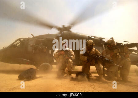 050826-F-9712C-032   The rotor wash of a UH-60 Black Hawk helicopter kicks up clouds of dust as U.S. Army soldiers - Stock Photo