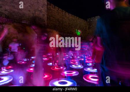 Jerusalem, Israel. 28th June, 2017. Jerusalem, Israel. People play on a pressure-sensitive cricles of light near - Stock Photo