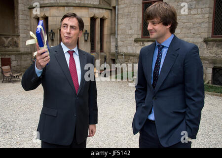 FILE - File picture dated 13 September 2012 showing Lower Saxony Premier David McAllister (L) speaking at the interior courtyard of the Marienburg with Ernst August, Crown Prince of Hanover, in Nordstemmen, Germany. McAllister and Ernst August visited the set of the KIKA youth series 'In Your Dreams', set in the time of the Welfenburg. Photo: Jochen Lübke/dpa