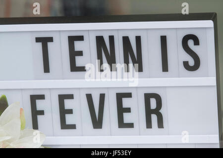 London UK. 29th June 2017. Shops in Wimbledon get into the spirit of tennis as the town prepares to host the 2017 - Stock Photo