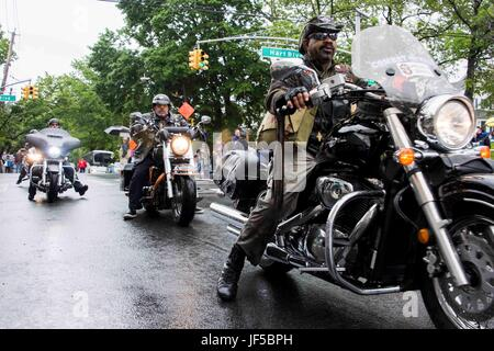 170529-N-XJ788-008   NEW YORK (May 29, 2017) Veterans ride motorcycles in the Staten Island Memorial Day Parade - Stock Photo