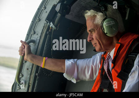Congressman Charlie Crist, U.S. Representative for Florida's 13th District, keeps a eye on the coastline during - Stock Photo