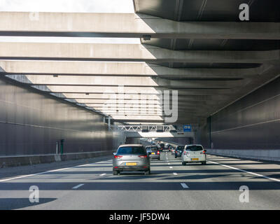 Traffic on motorway A4 passing Limes aqueduct under Old Rhine river, Leiderdorp, South Holland, Netherlands - Stock Photo