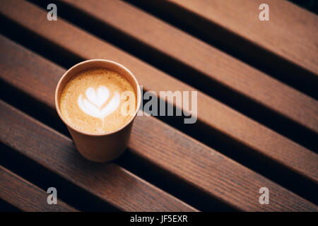 Paper cup of Coffee take-away, top view. Wooden table and place for text. - Stock Photo