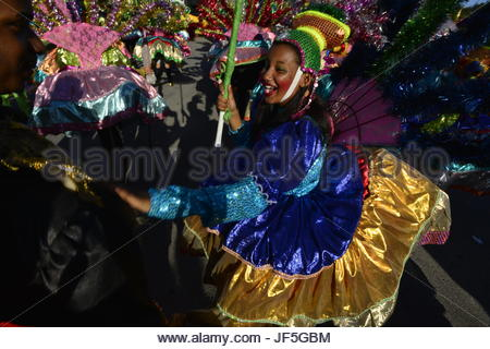 Women dressed in glittery costumes for Carnival. - Stock Photo