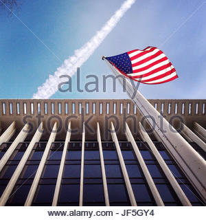 A flag flies outside the National Geographic Headquarters in Washington DC. - Stock Photo
