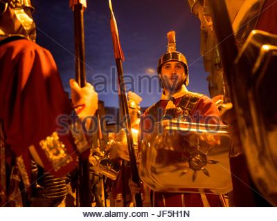 Actors dressed in costumes of the Roman Empire before an Easter Procession. - Stock Photo