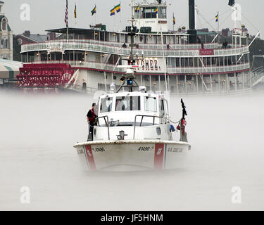 050207-G-3721C-393 A boat crew assigned to Coast Guard Station New Orleans patrols the Mississippi River during - Stock Photo