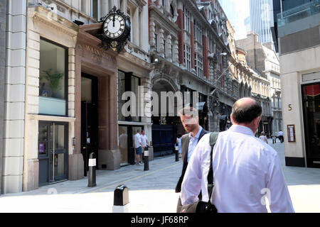 Businessmen walking along Throgmorton Street at noon in the City of London, Square Mile, financial district London - Stock Photo