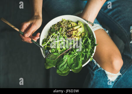 Clean eating breakfast with spinach, arugula, avocado, seeds and sprouts - Stock Photo