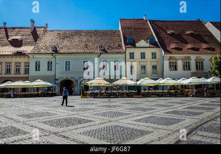 From left: Senator Velten Lederer House, Hans Wal House and Haller House Large Square in Historic Center of Sibiu - Stock Photo