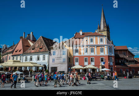 Historical houses and tower of Saint Mary Cathederal on a Small Square, Historic Center of Sibiu city of Transylvania - Stock Photo