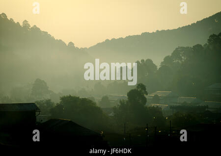 Early morning mist over town and hills, Kalaw, Shan, Myanmar (Burma) - Stock Photo
