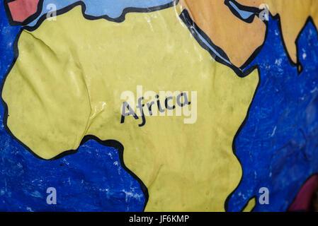 Handmade paper globe showing Africa. - Stock Photo