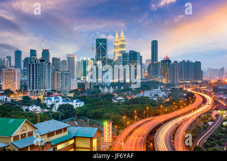 Kuala Lumpur, Malaysia highways and skyline. - Stock Photo