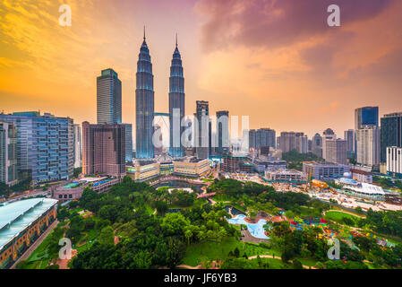 Kuala Lumpur, Malaysia park and skyline. - Stock Photo