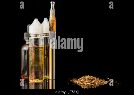 Electronic cigarette with bottles and grinded tobacco leaves - Stock Photo
