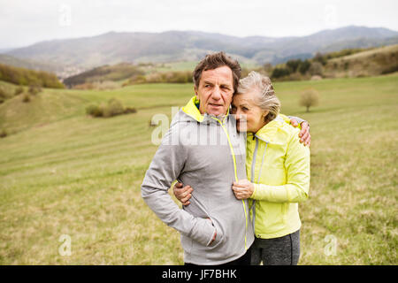 Beautiful senior runners resting outside in sunny autumn nature - Stock Photo