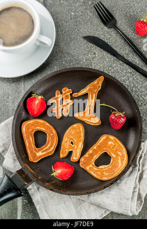 Celebrating Father's Day. Breakfast. The idea for a hearty and delicious breakfast: pancakes in form of congratulations - Stock Photo
