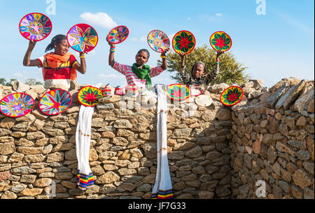 Axum, Ethiopia,, Joung craft vendors between the ruins of the baths of the Queen of Saba - Stock Photo