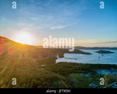 Sunset's over the small village of Riung on the island of East Nusa Tenggara in Indonesia. - Stock Photo