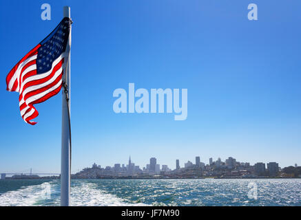 San Francisco, California, the city skyline seen from a ferry making a cruise on the bay - Stock Photo
