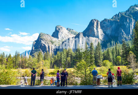 Yosemite Park, USA, Tourists looking at  the Cathedral Spires mountains - Stock Photo