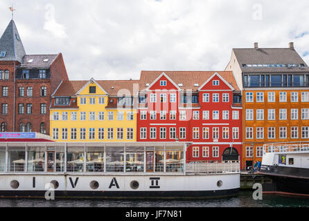 Copenhagen, Denmark, Traditional houses and boats in the Nyhavn canal - Stock Photo