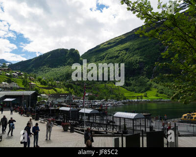 Geiranger village end of Geirangerfjorden Sunnmøre region of Møre og Romsdal county Norway busy with visitors and - Stock Photo
