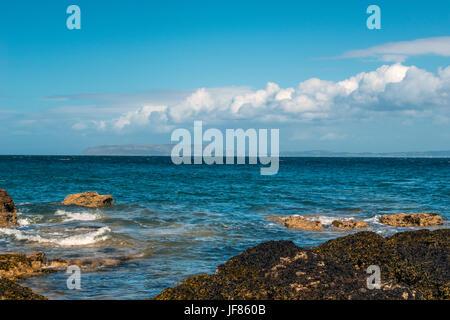 Beautiful seascape depicting North Wales coastal features, (Moel Wnion, Foel Ganol, Cefn Maen Amor, Conway Peninsula) - Stock Photo