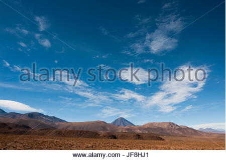 The Licancabur Volcano rises among peaks in the Andes Mountains. - Stock Photo