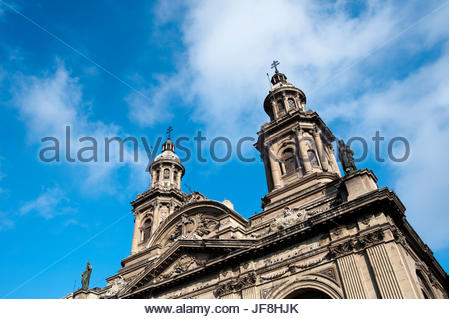 A low angle view of the towers atop Santiago's Metropolitan Cathedral. - Stock Photo