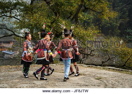 Chinese girls from the Dong ethnic minority group in Dail village. - Stock Photo