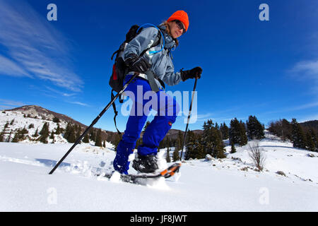 Winter hiking on Velebit mountain, Croatia - Stock Photo