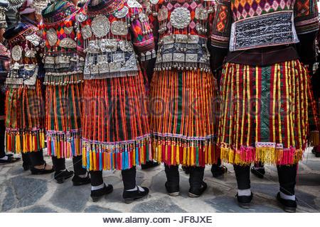 Women from the Mini skirt Miao ethnic minority in Datang village. - Stock Photo