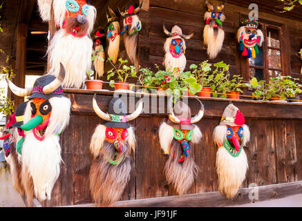 Traditional Romanian folklore masks in the outdoor Village Museum in Bucharest - Stock Photo