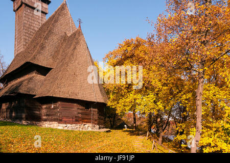 The church in the historic old village museum in Bucharest, Romania, in an autumn setting - Stock Photo