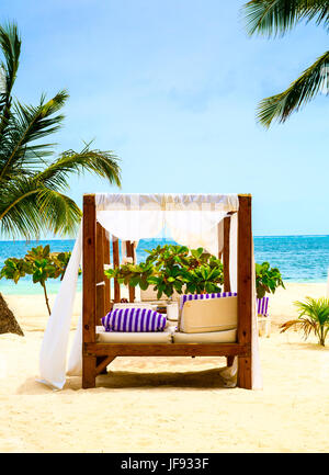 Relax on a luxury VIP beach with nice pavilion in a sunshine blue sky day - Stock Photo