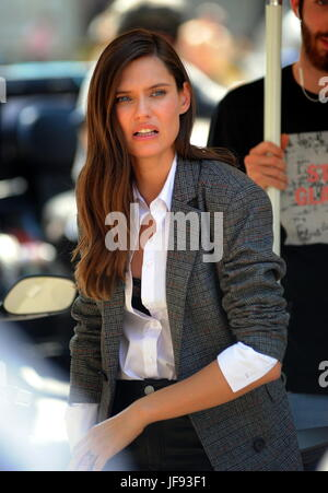 Model Bianca Balti shooting an advertisement for OVS, surrounded by police, bodyguards and staff in Milan  Featuring: - Stock Photo