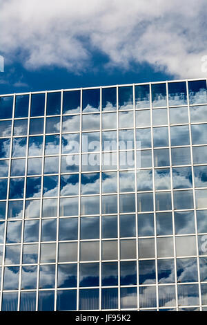 Clouds and sky reflected in windows - Stock Photo